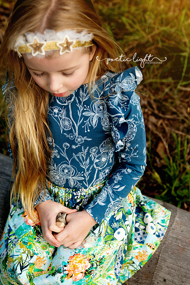 Willow Dress photographed with small wooden toy by Poetic Light Photography