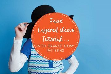 faux layered sleeve with orange daisy patterns