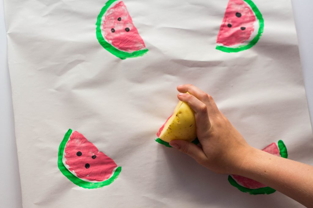 Let your kids use a potato stamp to make unique wrapping paper.