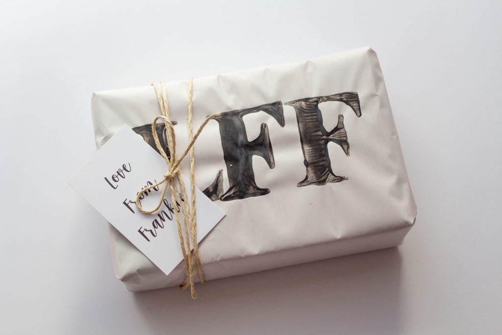 hand stamping wrapping paper is the perfect way to present your handmade gifts.